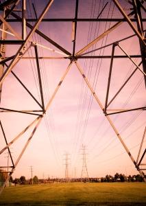 sunset between powerlines