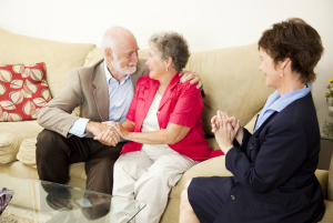 therapist looks on as a senior couple works out their issues